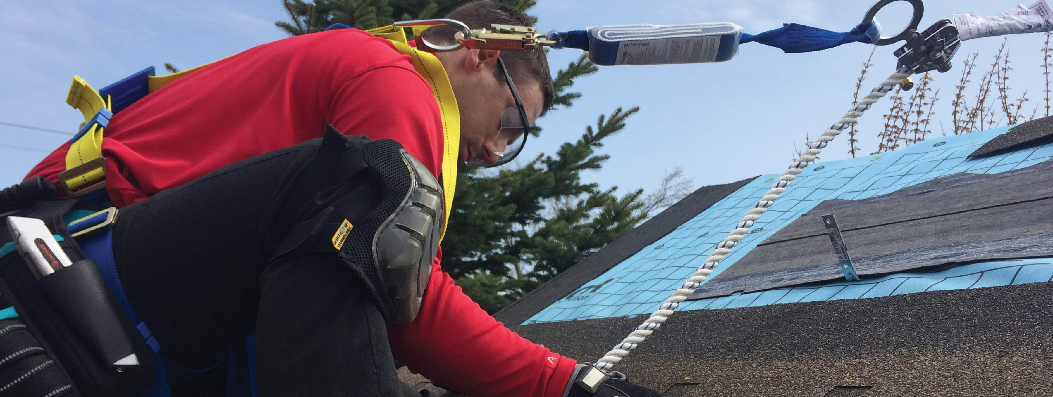 CARE - male roofer working